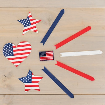 Heart and stars in american flag color and stripes on wooden surface