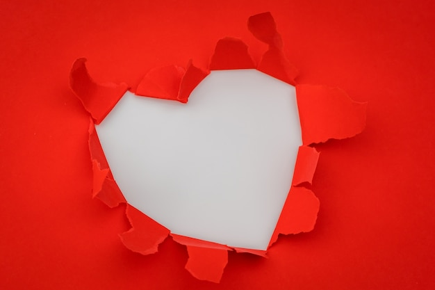 Heart torn paper with space for text .