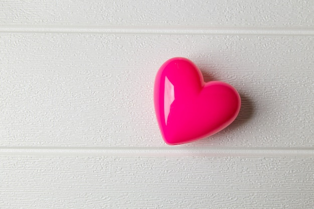 The heart on white wood background.
