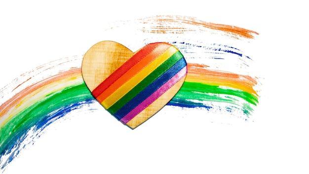 Сердце с символами лгбт на фоне радуги. концепция лгбт для дизайна. гей-прайд радуга лгбт-флаг дизайн фона. символ движения лгбт. день святого валентина.