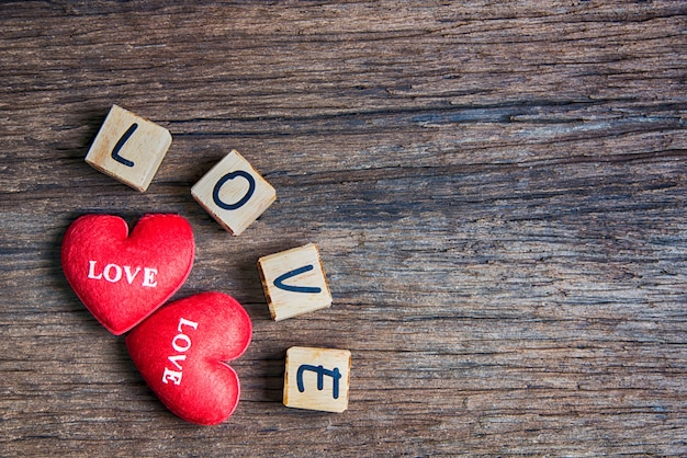 Heart with wooden letter: love