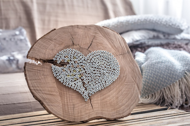 Heart on a wooden table in the interior of the room