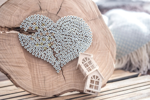 Heart on a wooden wall in the interior of the room