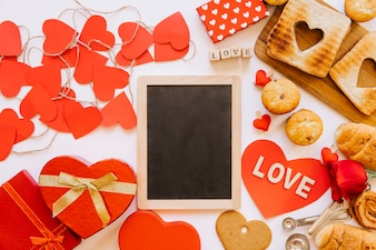 Hearts and pastry around chalkboard