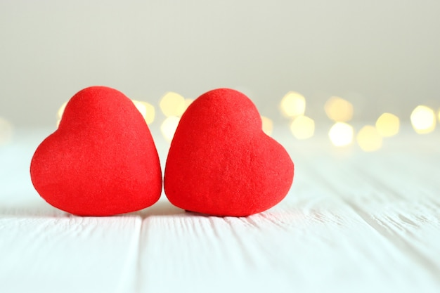 Hearts on the background of the lights of a garland