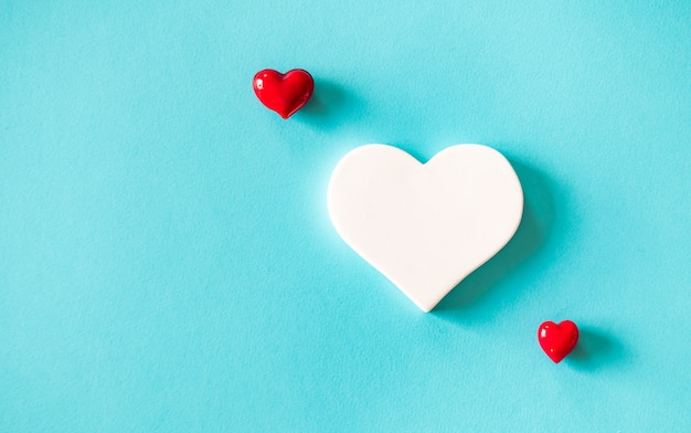 Hearts on blue background. valentines day concept.