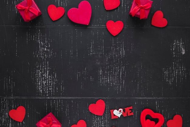 Hearts and boxes on black background