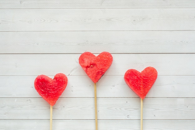 Hearts carved from watermelon on a stick. concept of valentine's