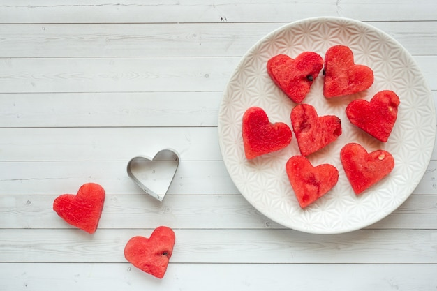 Hearts carved out of watermelon. concept of valentine's day copy