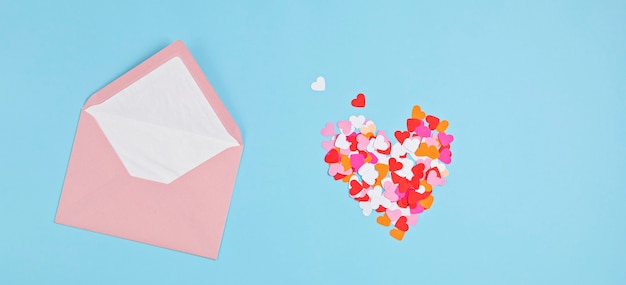 Hearts confetti and pink envelope.