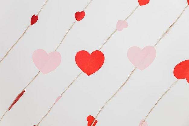 Hearts laid on ropes on a white background