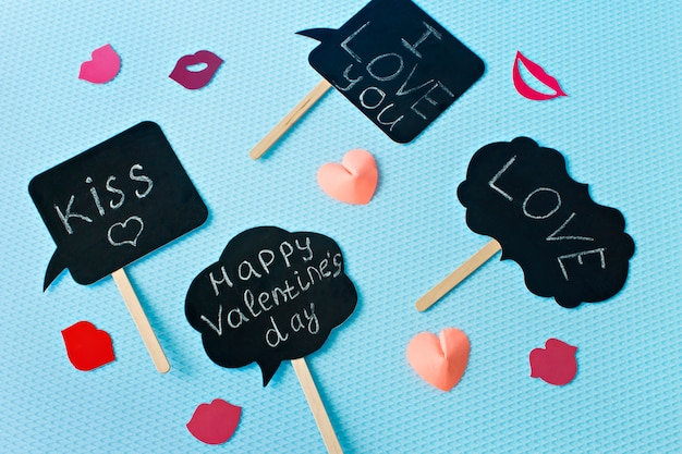 Hearts and lips on a blue background