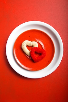 Hearts on plate on red