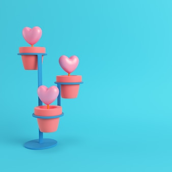 Hearts in a pots with stand on bright blue background
