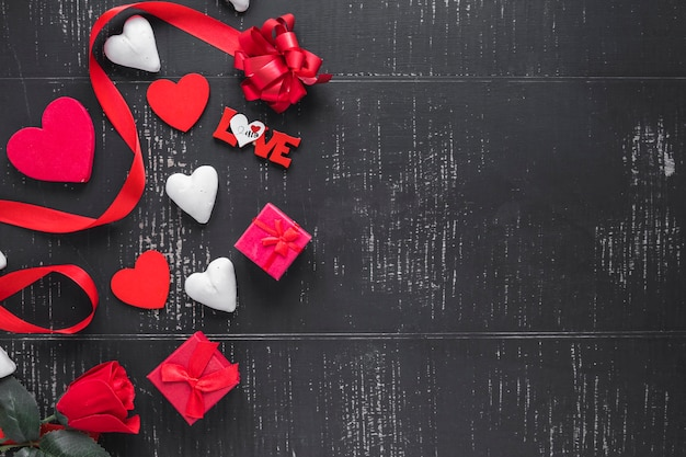 Hearts and presents on black background