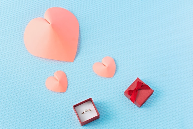 Hearts and ring on a blue background