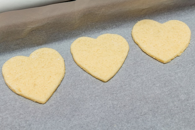 Hearts shape cookies cooking process.