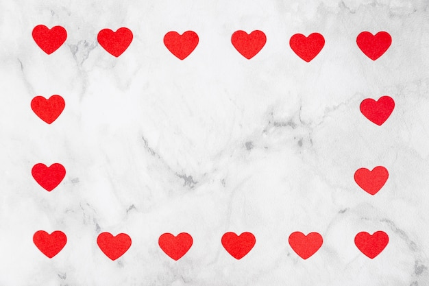 Hearts surrounding marble copy space