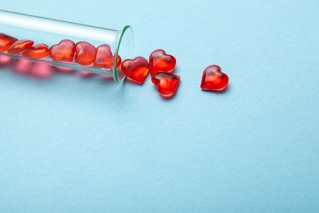 Hearts and test tube. baby from tube vitro glass.