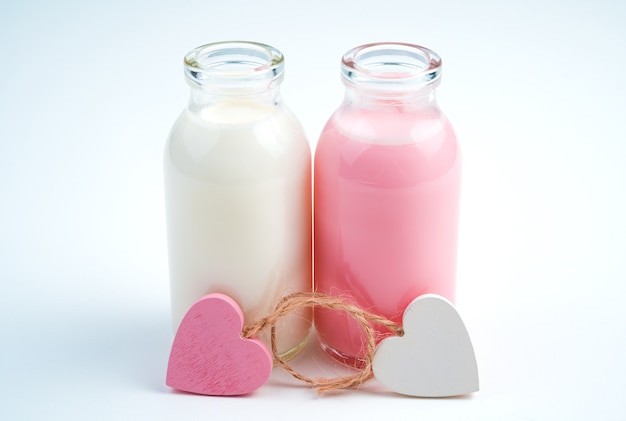 Hearts and two bottles of milk drink. concept of drinks