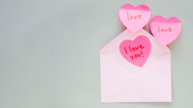 Hearts with i love you inscription in envelope