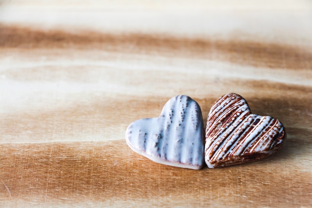 Hearts on wooden background. valentine's day concept