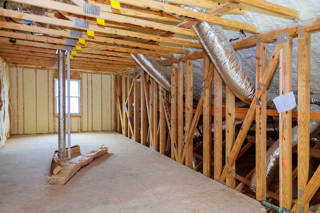 Heat isolation in a new prefabricated house with mineral wool and wood.