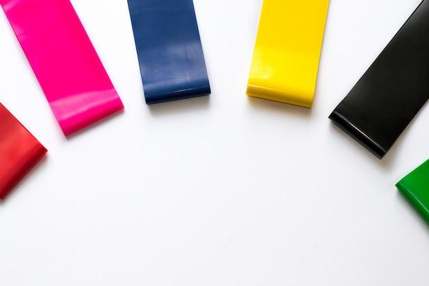 Heathy lifestyle concept - elastic fitness gum expanders for women