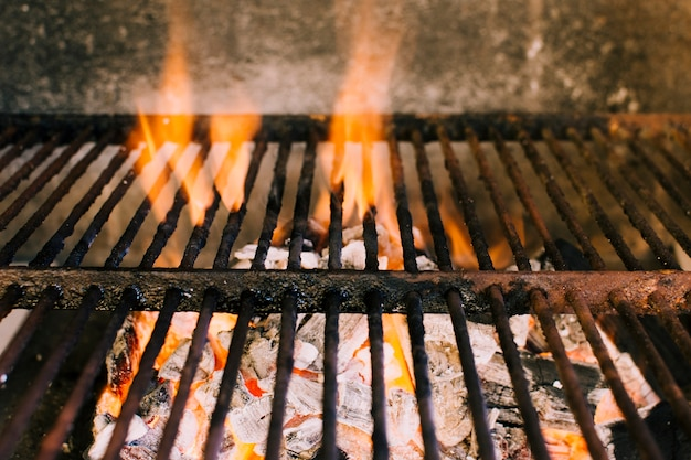 Heavy fire for grilling on hot charcoal