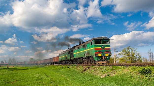 Heavy freight train hauled by diesel locomotive in ukraine