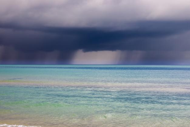 Heavy leaden clouds with rain over the blue sea. typhoon over the black sea.