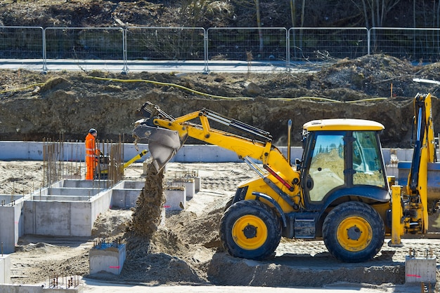 Heavy machinery at a construction site growth of the real estate market construction of the foundation for the future office and residential building