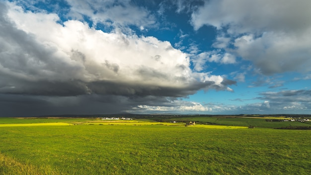 Heavy rainy clouds over the northern ireland field