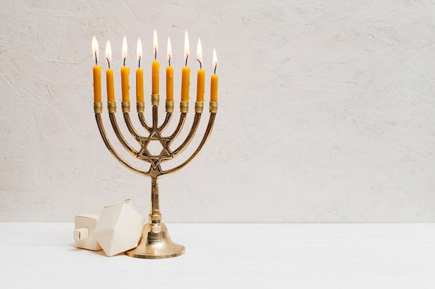 Hebrew menorah with candles burning