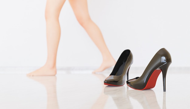 Heels with barefoot person