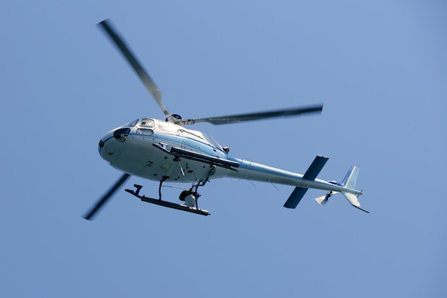 Helicopter flying over the blue sky