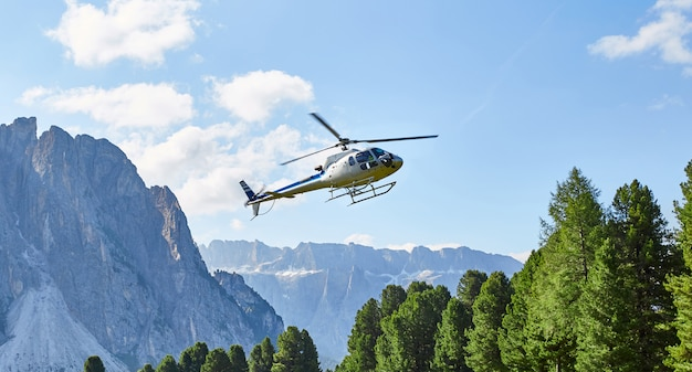 Helicopter flying in val gardena