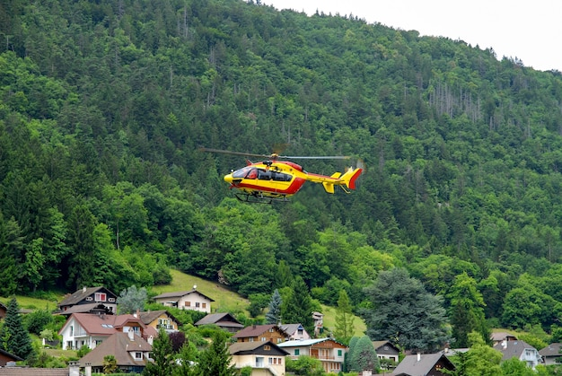 Helicopter in the french alps mountains rescue