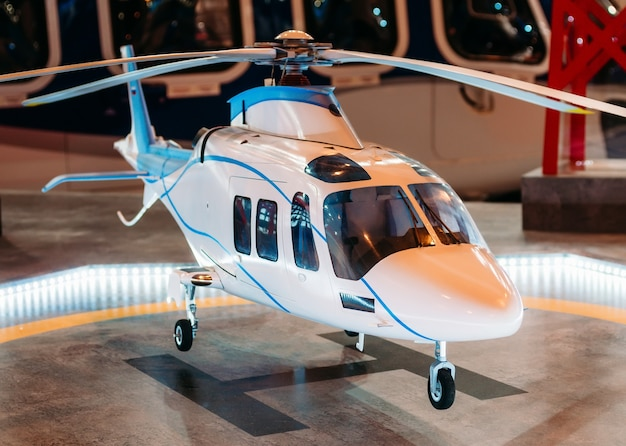The helicopter on the helipad with a light beacon lights on the platform.