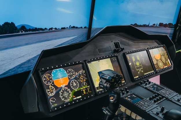 Helicopter pilot cabin and control panel with steering wheel, simulator.