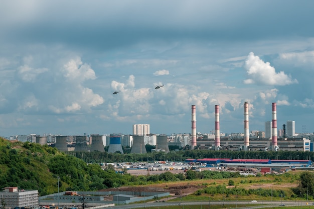 Helicopters over the city in industrial area on the outskirts of moscow