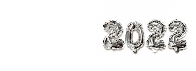 Helium balloons 2022, silver foil numbers on grey background. party decoration, anniversary sign for holidays, celebration, carnival