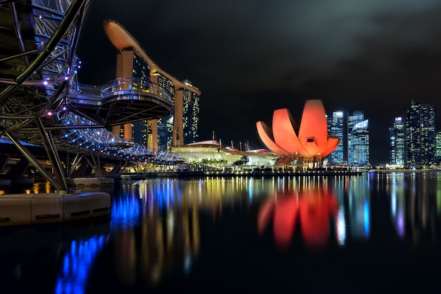 The helix bridge, marina bay sands and artscience museum with downtown in background, singapore