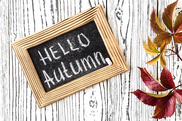 Hello autumn greeting text on chalkboard.