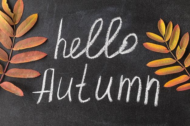 Hello autumn white chalk lettering on blackboard.
