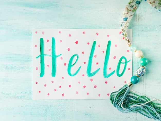 Hello card on pastel with necklace