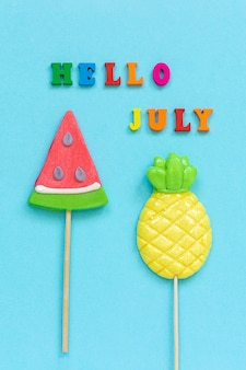 Hello july pineapple watermelon lollipops. concept vacation or holidays template greeting card, postcard