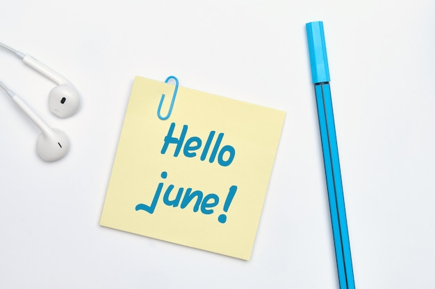 Hello june message on a notepad
