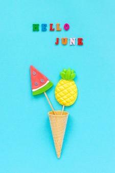 Hello june, pineapple and watermelon lollipops in ice cream cone.