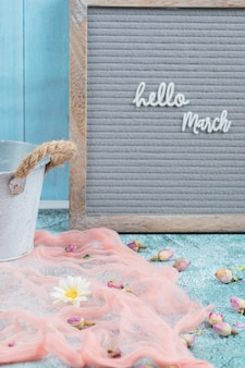 Hello march poster with pink scarf and flower blossoms around